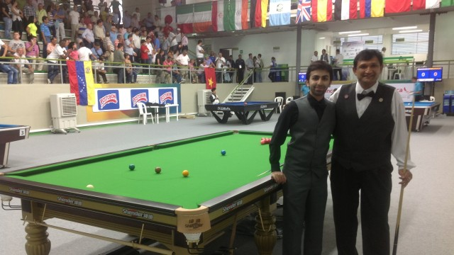 The United States' Ajeya Prabhakar (pictured right) with India's Pankaj Advani prior to their World Games Snooker match - Photo © SnookerUSA.com