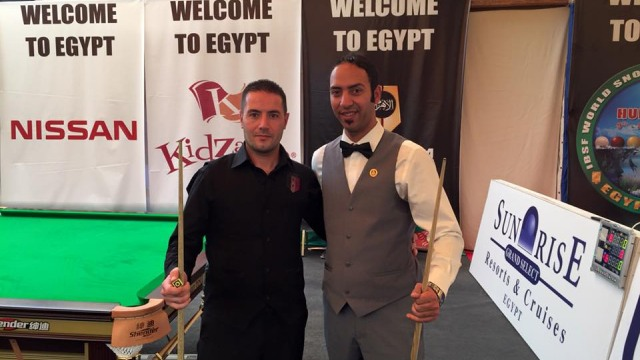 Ahmed Aly Elsayed (right) pictured with his first opponent in Group G, Haitham Shikh Khalil of Syria - © IBSF