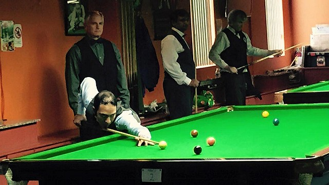 Round of 16 play at the 2015 United States National Snooker Championship, with Ahmed Aly Elsayed pictured at the table, playing Jeff Szafransky (upper left), while in the background, the defending champion Ajeya Prabhakar (center) is up against Don Sitarski - Photo © SnookerUSA.com